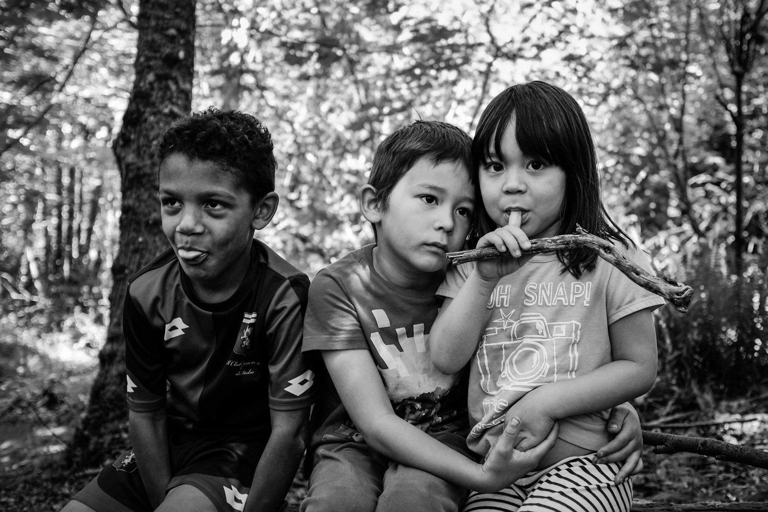 children hug forest portrait siblings Seattle