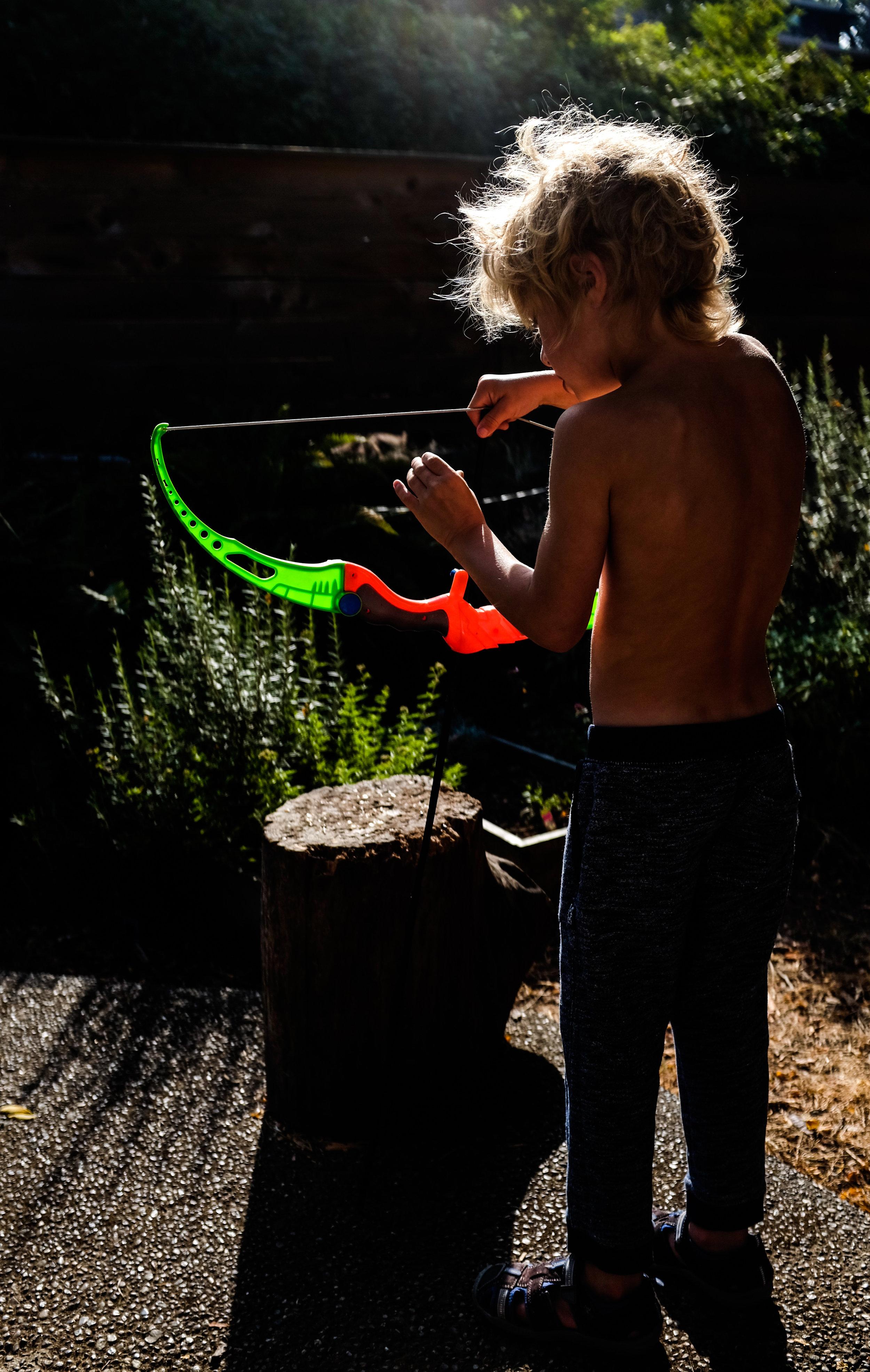 archery children Seattle portrait toy