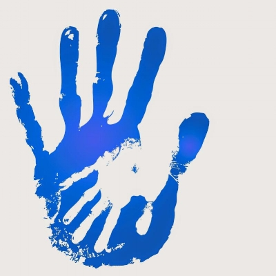 adult and child hands blue and white.jpg