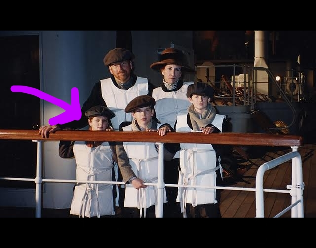 "A still as an extra on the set of ""Titanic."" There I am, literally holding the bar high even at so young an age."