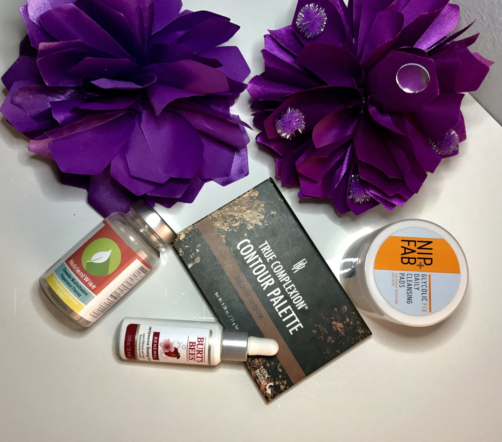 Favorites List:    Nip + Fab Glycolic Fix Daily Cleansing Pads   Burt's Bees intensive Firming Serum   Black Radiance True Complexion Contour Palette   Nutrient Wise chewable multivitamin