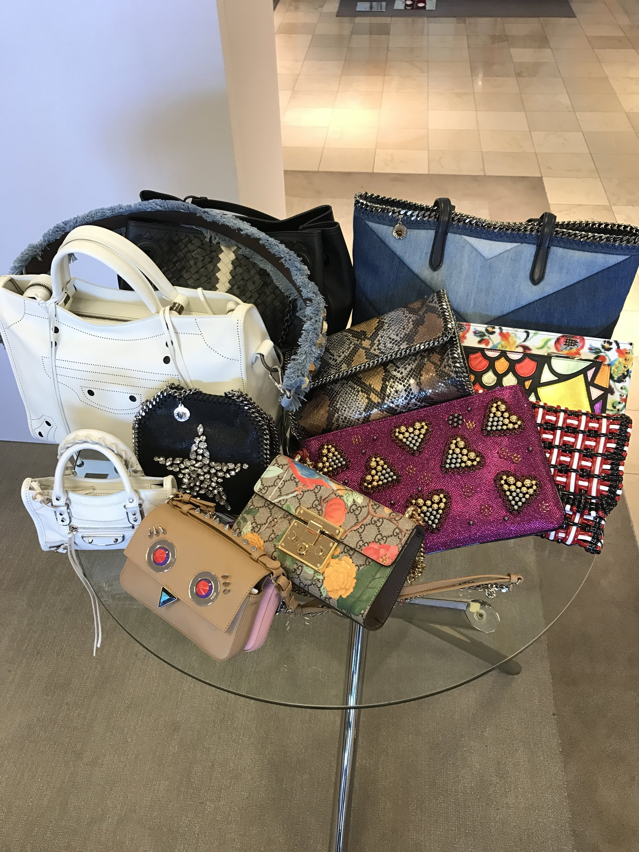 Gotta love a bag that makes a statement!!!! The in thing to have at the moment is the mini bag/regular bag combo. Yes you carry both at the same time ;). Sounds crazy, but it's a thing.