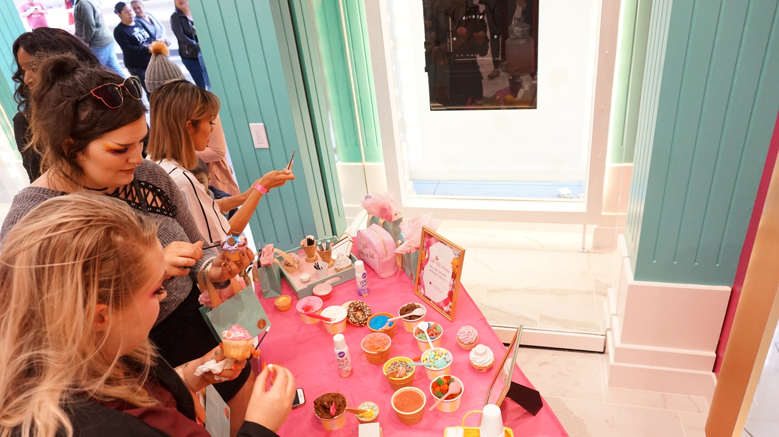 There was a Cupcake station where we tested out the power of the Lip whips!!! Beauty Bakerie Lip Whips, which is their liquid lipsticks are known for all day staying power!! You can eat and not have lipstick all over your face! Amazing right!!