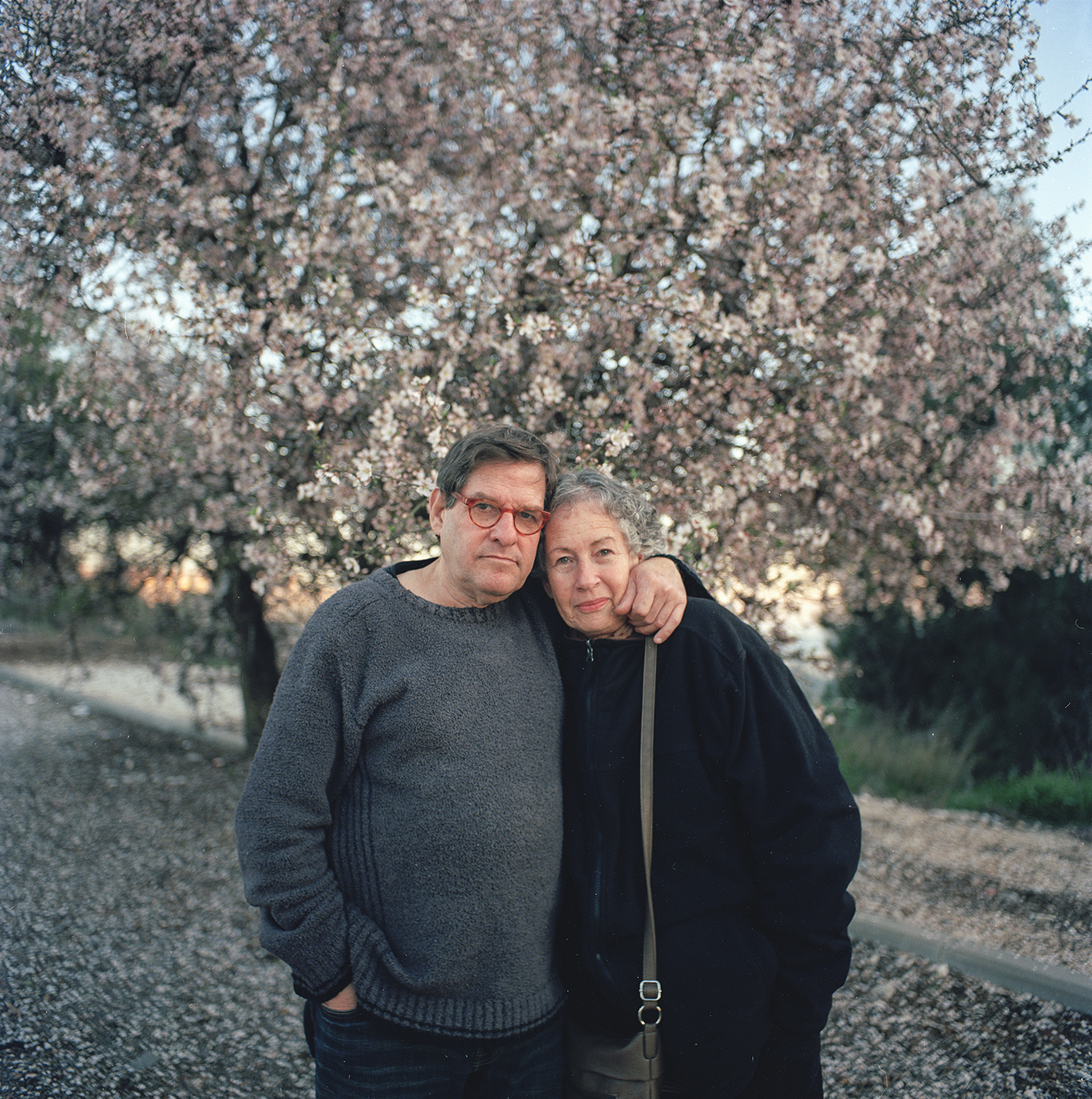 Mom and dad by the almond tree