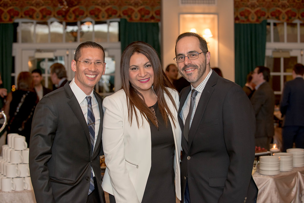 Dr. Douglass Lee (Southwest Gastroenterology) posing with Dr. Rogelio Silva (GI Associates) and his lovely spouse.