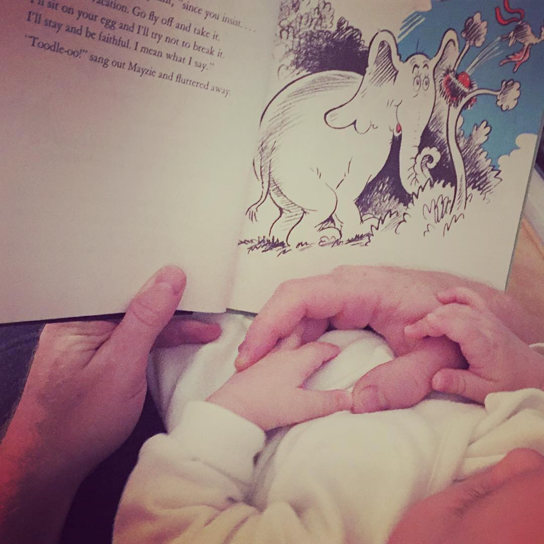 What a precious photo from one of my clients. Look at the hands!  I suspect your baby got a lot of toys and books for holiday gifts. Don't wait on bringing out the books. It's never too early to read to your little ones.  And if you're overrun with toys, be sure to listen to Kara's podcast with Preschool and Beyond on  taming the toys  (using toy rotation to enhance play and learning). You can read about toy rotation  here  on our blog.
