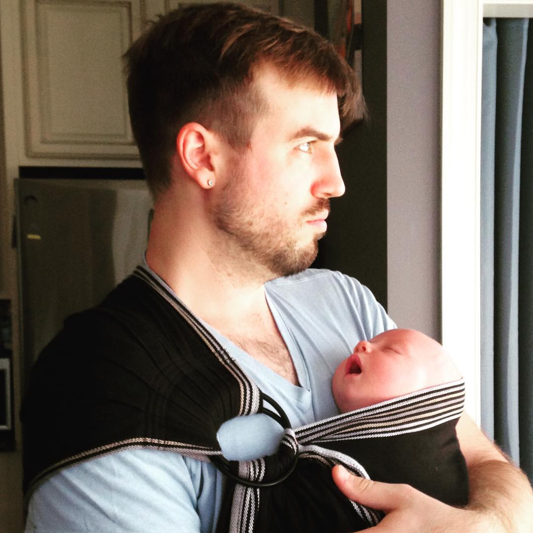 We love our babywearing dads. This one does it like a Greek god. #babywearingdads