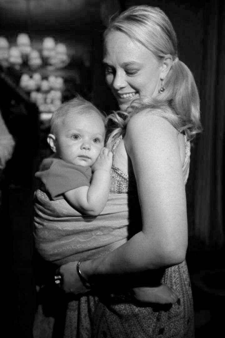 Mom wearing baby in sling