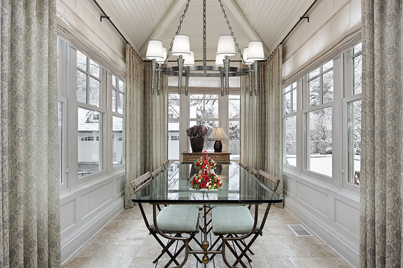Two holiday centerpieces add a dash of cheer to this dining room with a view featuring the  Prosecco Chandelier .