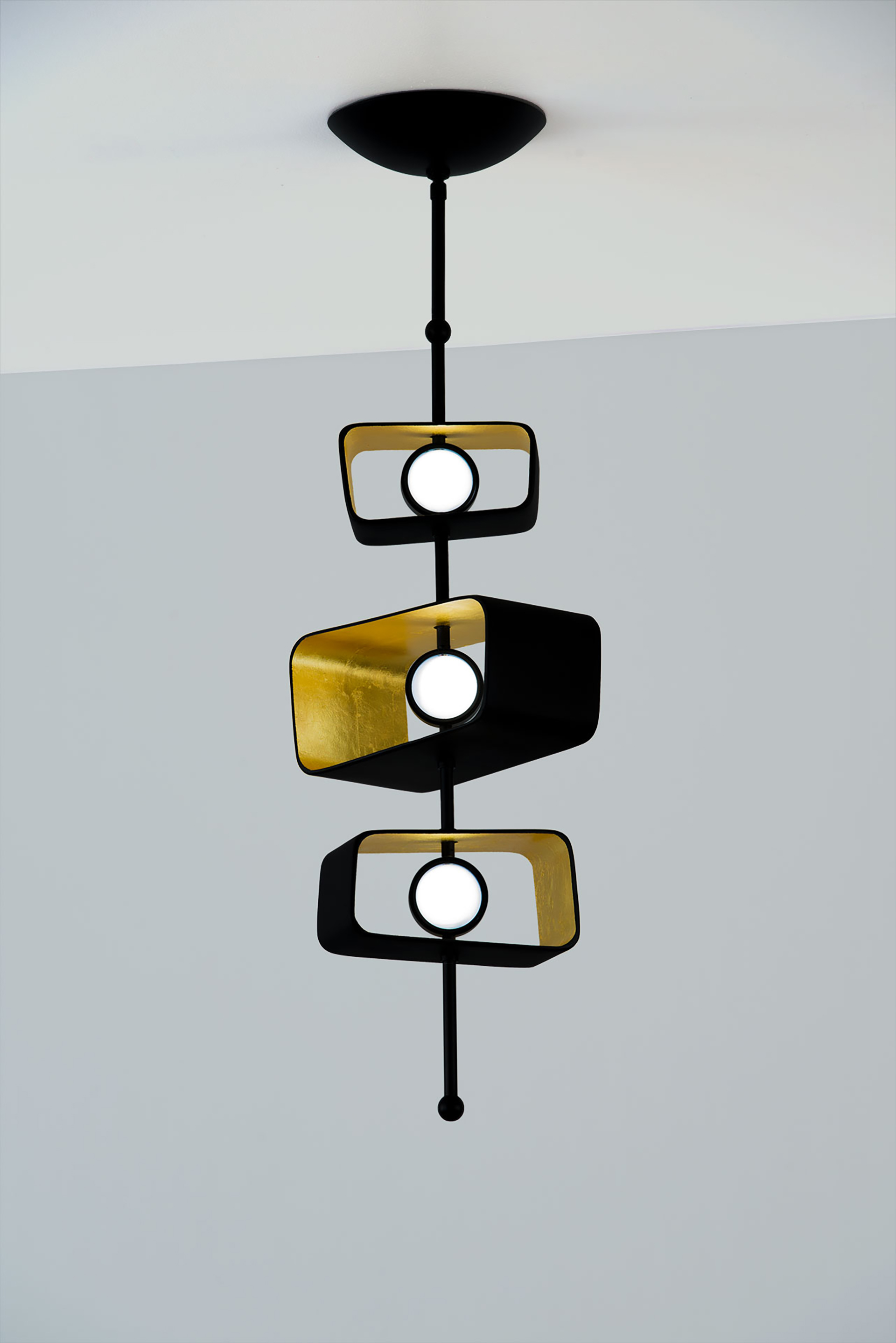 Totem 3 Pendant - Trapezoid fixtureshown in Coal with22k Yellow Gold Leaf inside cast form