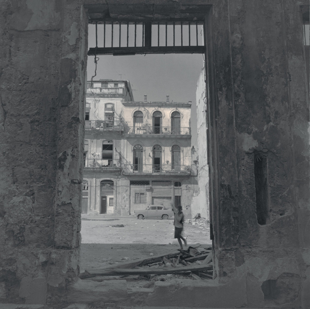 Boy by a ruined house, 2003