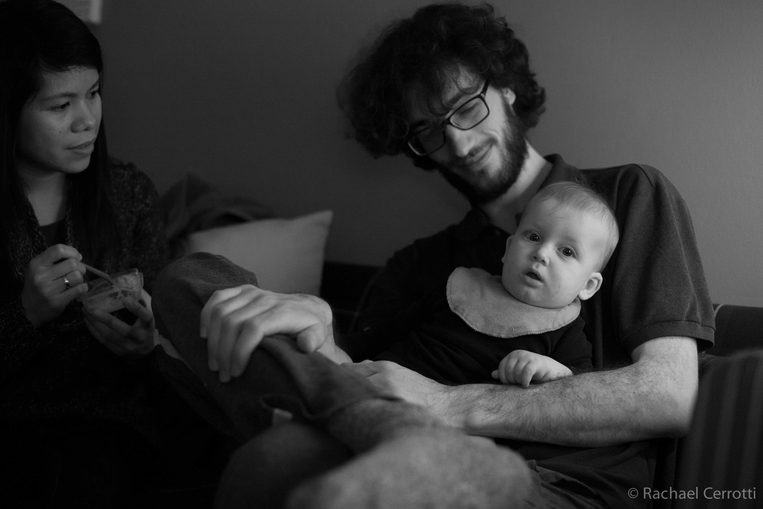 Ruben Bergmann, Dasa's grandson,sits with his son and his step-mother, Let.