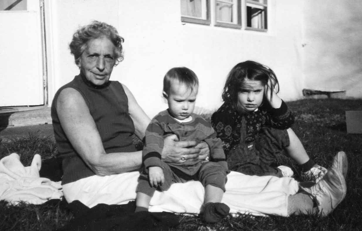 Hana sits with her two grandchildren almost a half century after immigrating to America. Rachael (the artist) is on the right. She is the fourth in a line of seven grandchildren.
