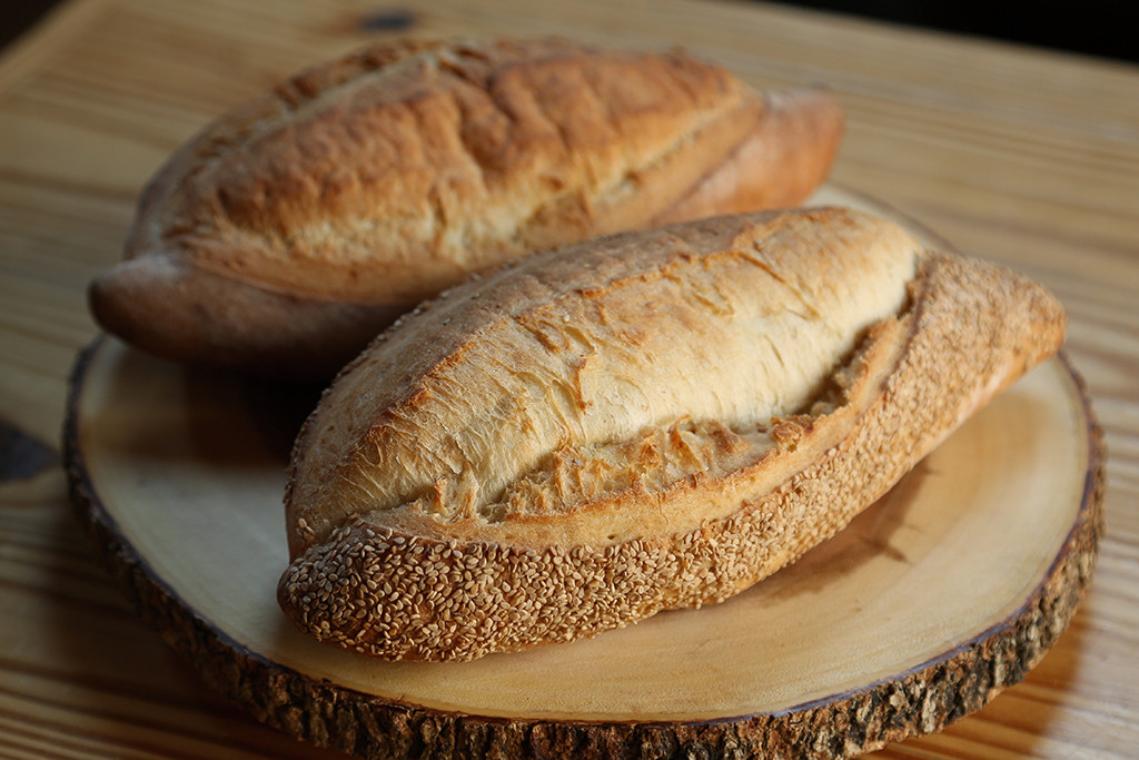 Batard   Plain or sesame, ours is a classic French batard, made in the traditional method (with flour, yeast, and salt) resulting in a crisp crust and chewy interior. Shorter and wider than a baguette, our batard is a universal bread that goes with everything.
