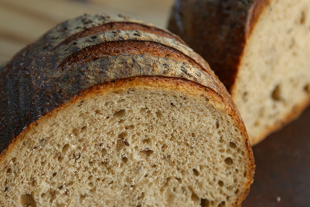Caraway Rye   The lightest of our ryes, this bread is both yeasted and naturally leavened with rye starter. It's traditional deli rye flavor comes from its caraway seeds. It is our closest bread to a Jewish Rye, and has excellent shelf-life. Its flavors improves over the course of several days.