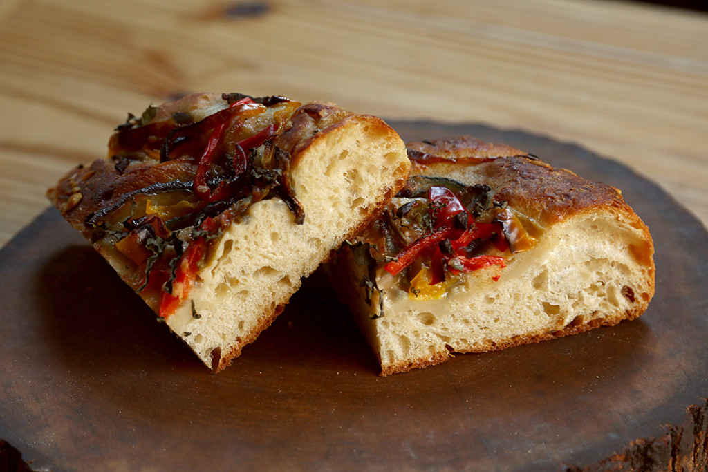 Focaccia   Focaccia is a ciabatta-style dough baked in a pan lined with olive oil and topped with savory ingredients. Light and airy, with a rich flavor, it is wonderful when reheated the next day too.