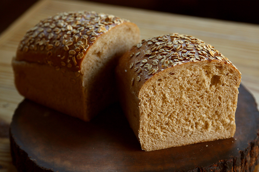 Honey Wheat   Oats, wheat flour, and honey make this a tender loaf perfect for sandwiches. It has a consistent crumb and is also perfect for French toast. Bathed in oats before baking, it is a very moist bread.