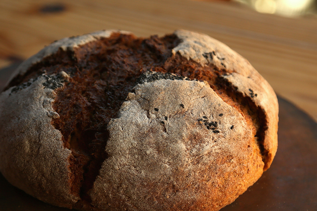Russian Black Bread   75 percent rye, 25 percent high gluten. This bread has a yeast and sourdough starter, with Elm Street Bakery coffee as an ingredient, and topped with black caraway seeds.