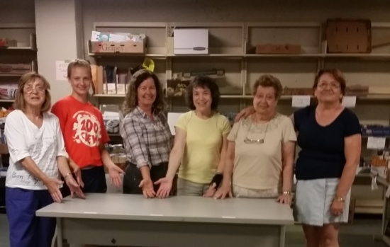 Volunteers sorting books are happy to clear the backlog of unsorted books.