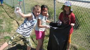 Help out the environment  - Kids picking up garbage in and around their school (to help their custodians and the community).