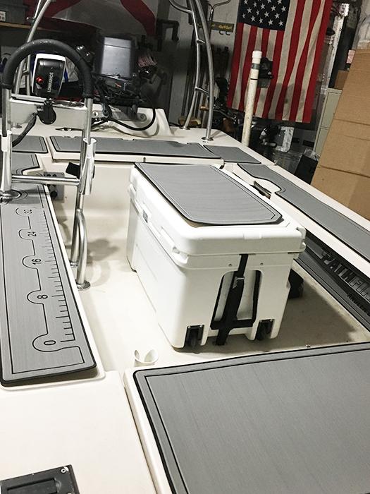 Strap Deck Plates and Straps securing Kysek 50 cooler in cockpit of Pathfinder poling skiff.