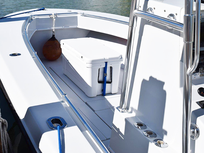 Strap Deck Plates and Straps securing a Yeti 125 forward of the console on a Contender 28