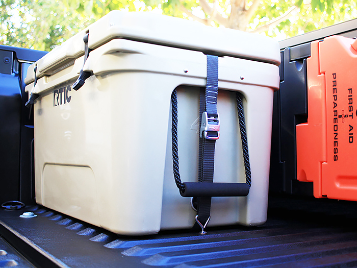 Strap Deck Plates with third-party straps securing RTIC 45 cooler in truck bed
