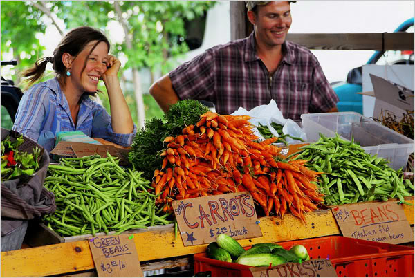 Farmers' Markets support your local farming community. Image courtesy of  Global Roots .