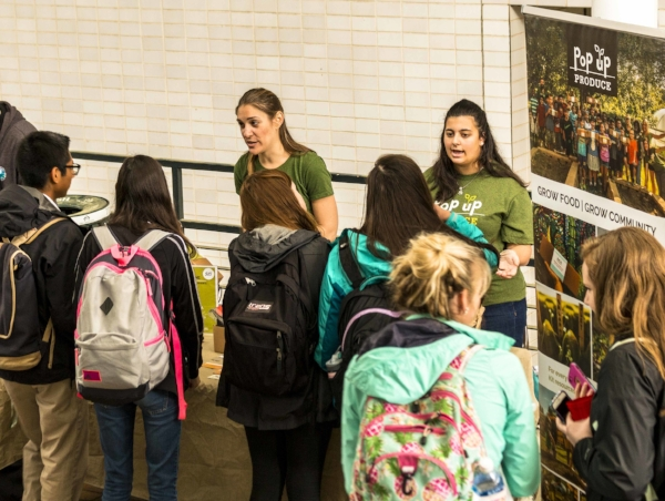 Amanda Zullo and Giana Spear educating University students about our work in the community.