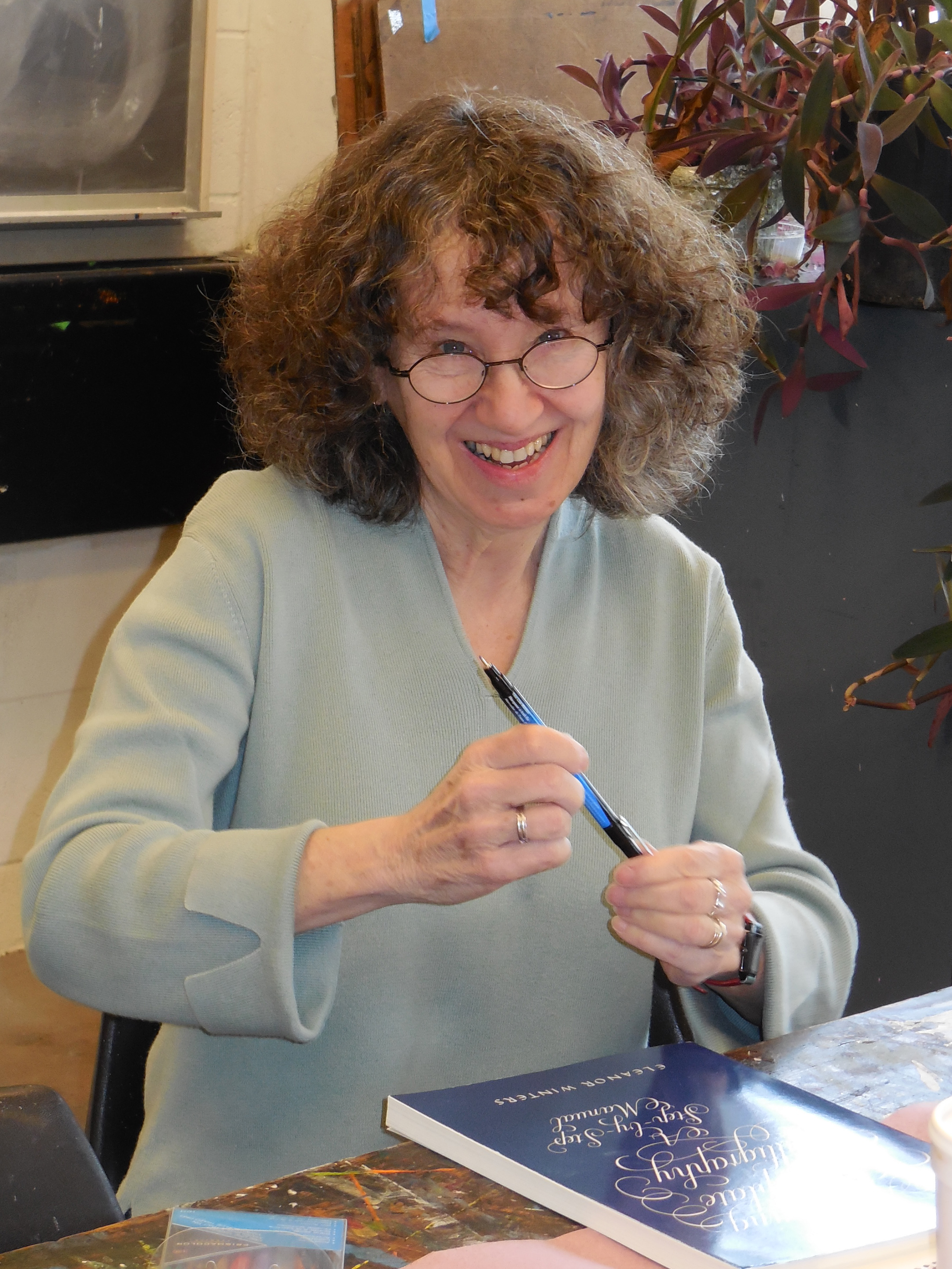 "Eleanor Winters while signing her ""Mastering Copperplate Calligraphy A Step - by - Step Manual"""