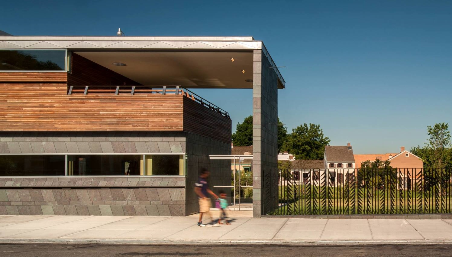 The new Weeksville Heritage Center, with the Hunterfly Road Houses in the background,   via