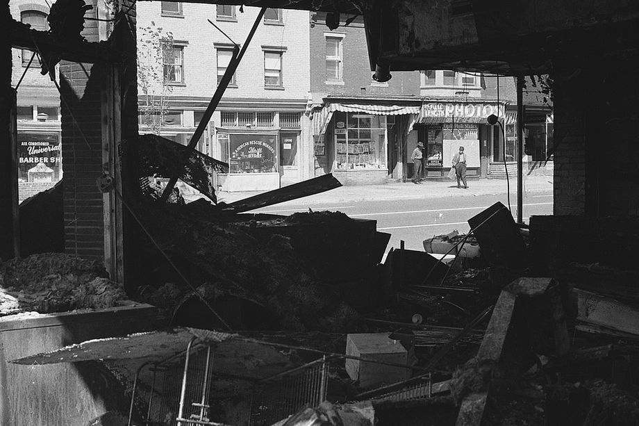 Damage to a storefront after the riots   via