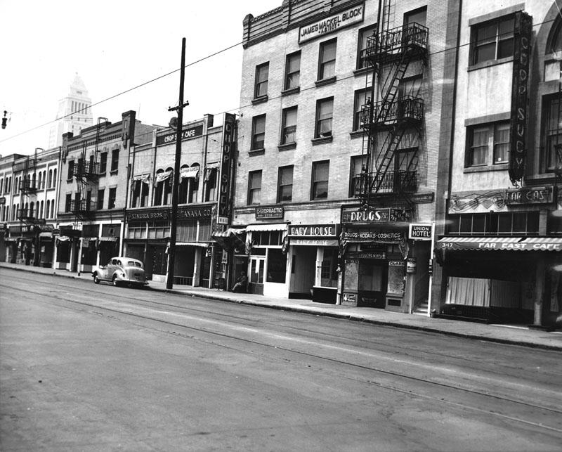 A deserted E. First Street in 1942, after the forced removal of Japanese Americans. The Mikado is the second building from the left  via