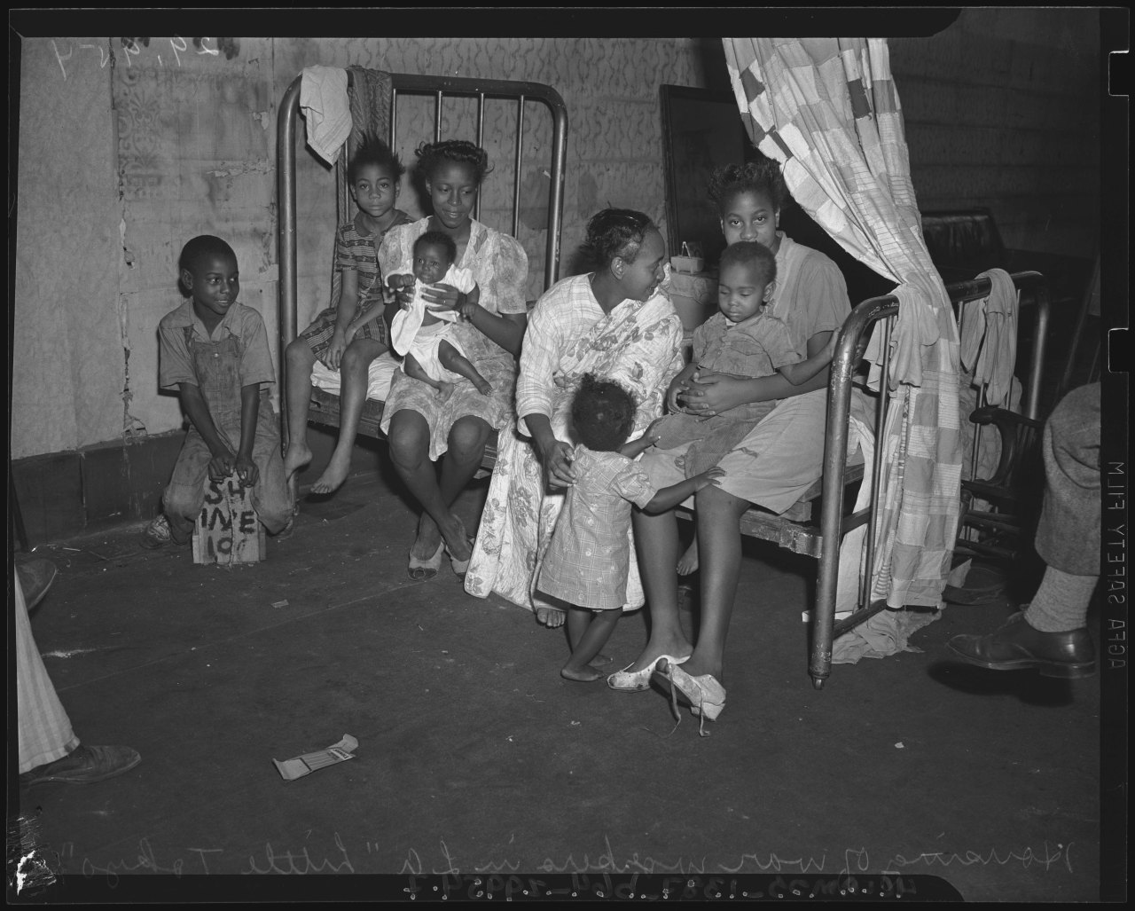 Residents of overcrowded Bronzeville  via