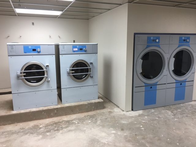 The washers are stainless steel fronts.  The stickers have been left on during final construction.