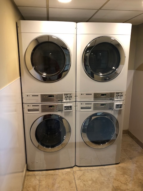 Here are some good looking LG coin stack washer/dryers.  They are being used in a hotel guest laundry.