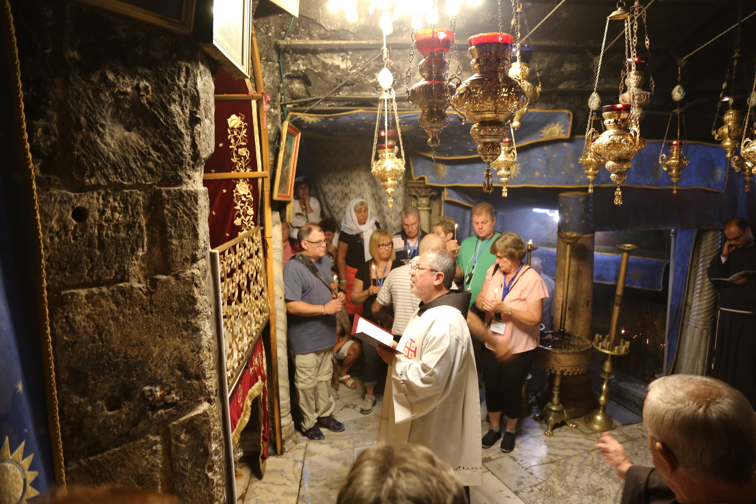 Praying mid-day prayer with the local, Catholic community in Bethlehem at the Nativity Grotto (where Jesus was born) under the Church of the Nativity.