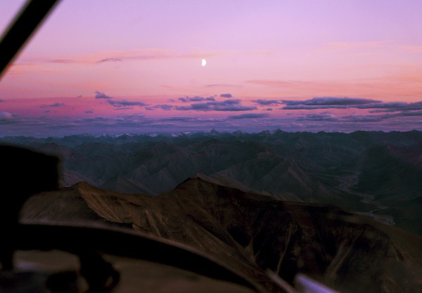 Sunset over the Mackenzie Mountains from the window of a float‐plane.