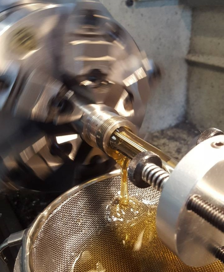 Andersen uses a wet reaming system to flush metal chips away from the reamer's cutting surface