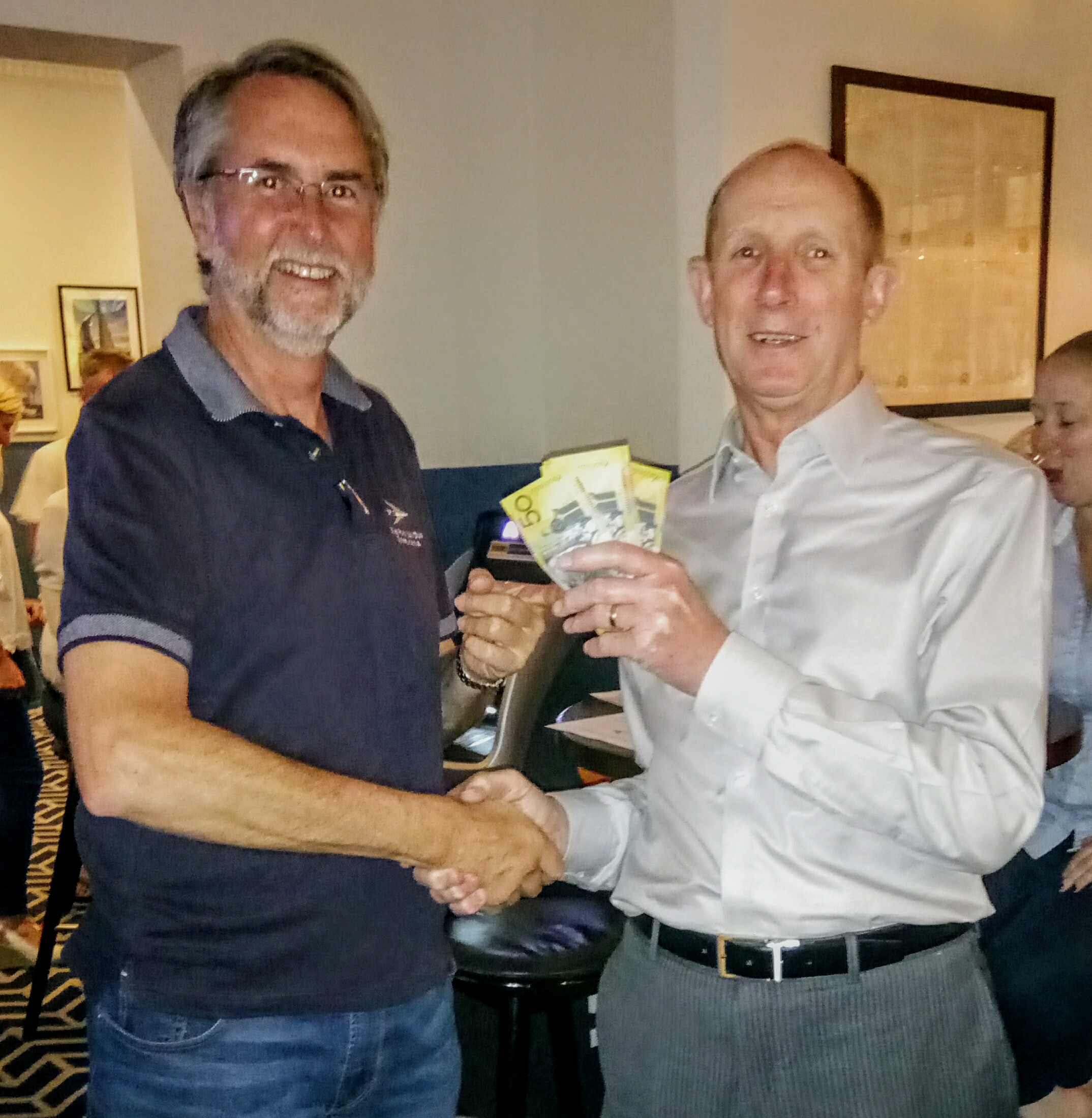 Vice Commodore, Chris, handing over the dosh to a very happy Doug.