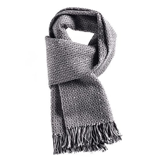 Occhietto scarf handwoven by Brozzetti of Perugia. Black and white silk and cashmere cotton blend with hand knotted fringes.