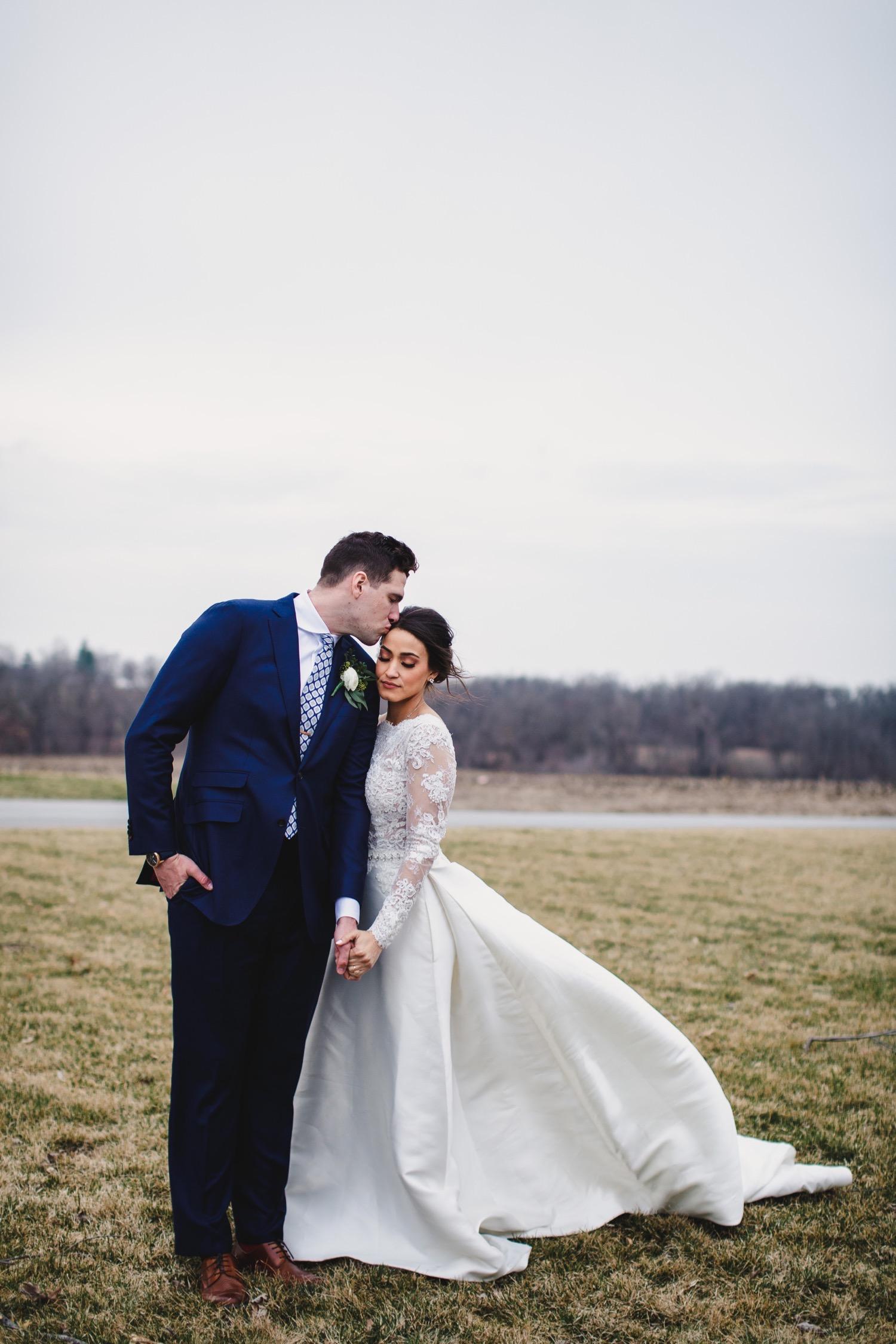 070_Hennings-1217_Kansas_Kelsey_Missouri_Center_Wedding_Diane_Photography_Marshall_Jackson's_Event_City.jpg