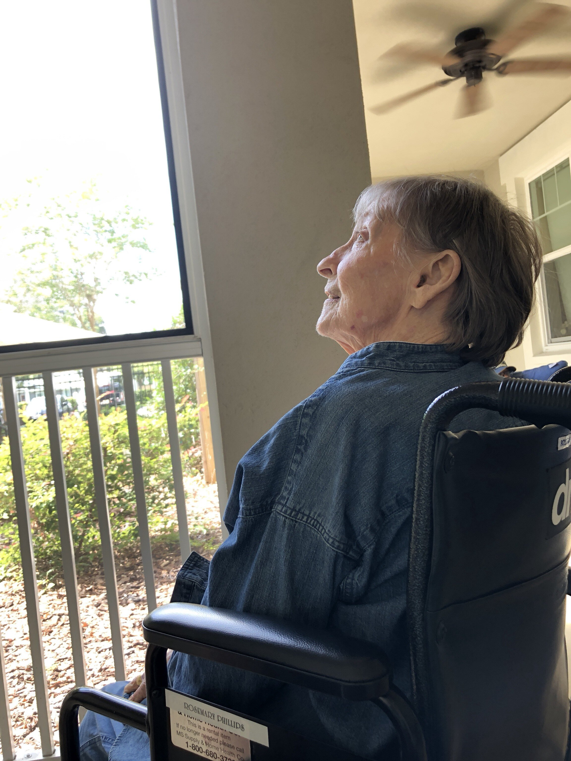 My mom enjoying some time on the porch at her memory care home—photo by TK