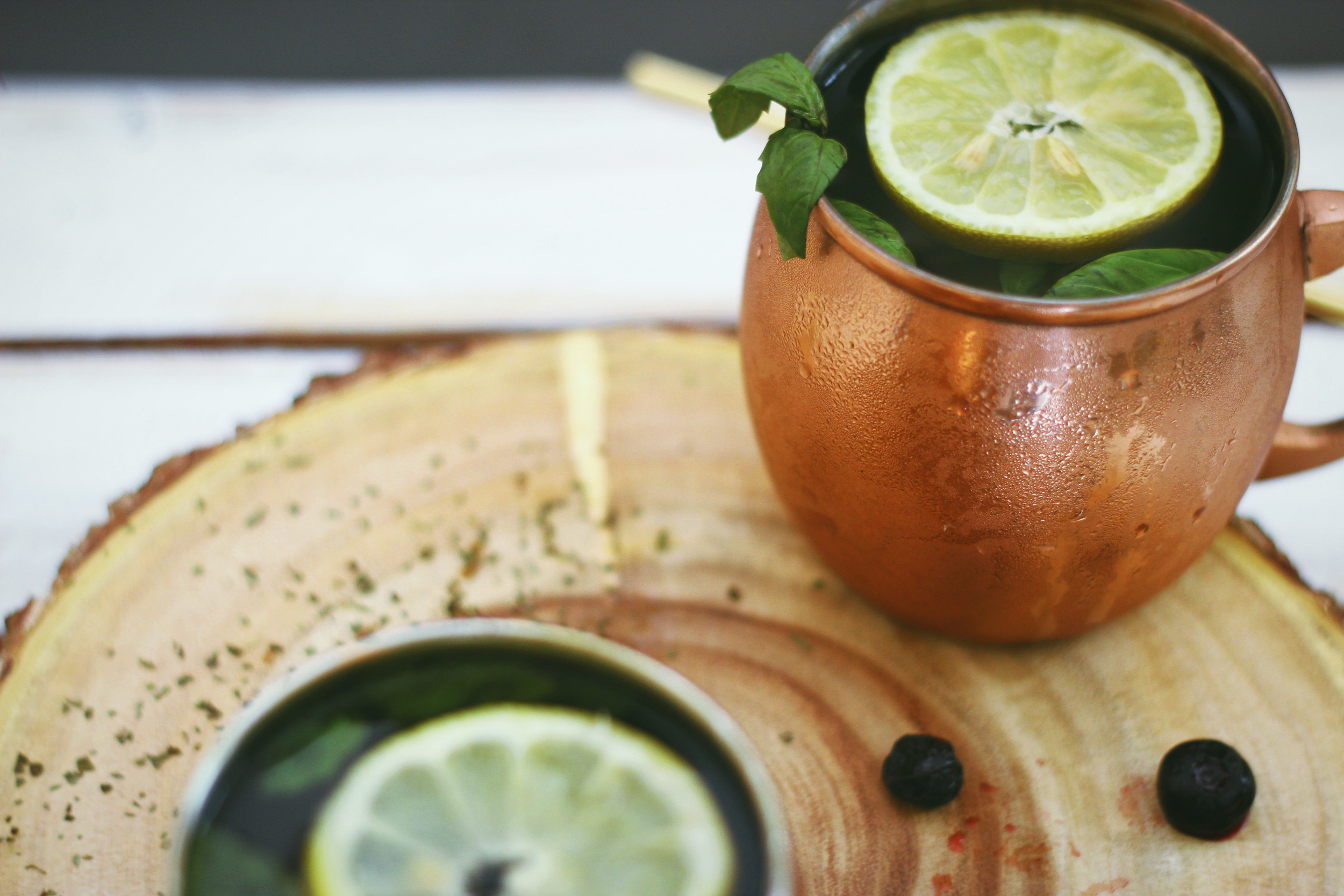 Fun twist on a classic cocktail- blueberry basil moscow mules for easy and delicious entertaining