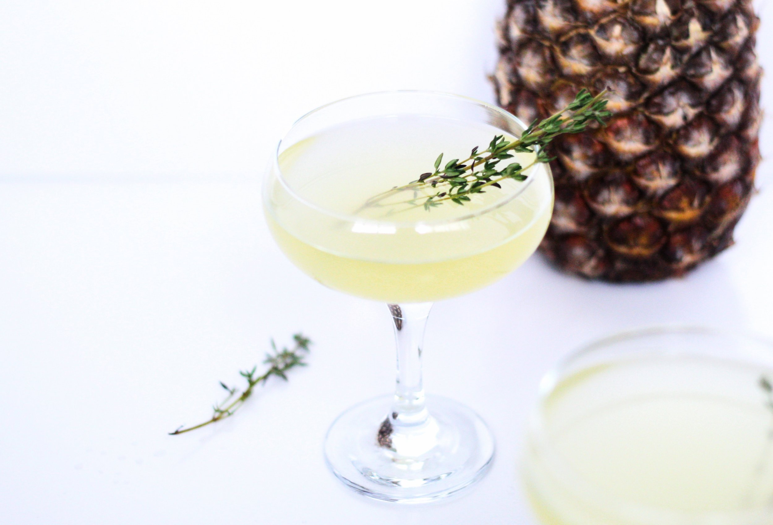 champagne cocktails, french 75 with pineapple