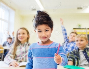 36288086-education-elementary-school-and-children-concept-happy-little-student-with-pen-girl-over-classroom-a-Stock-Photo.jpg
