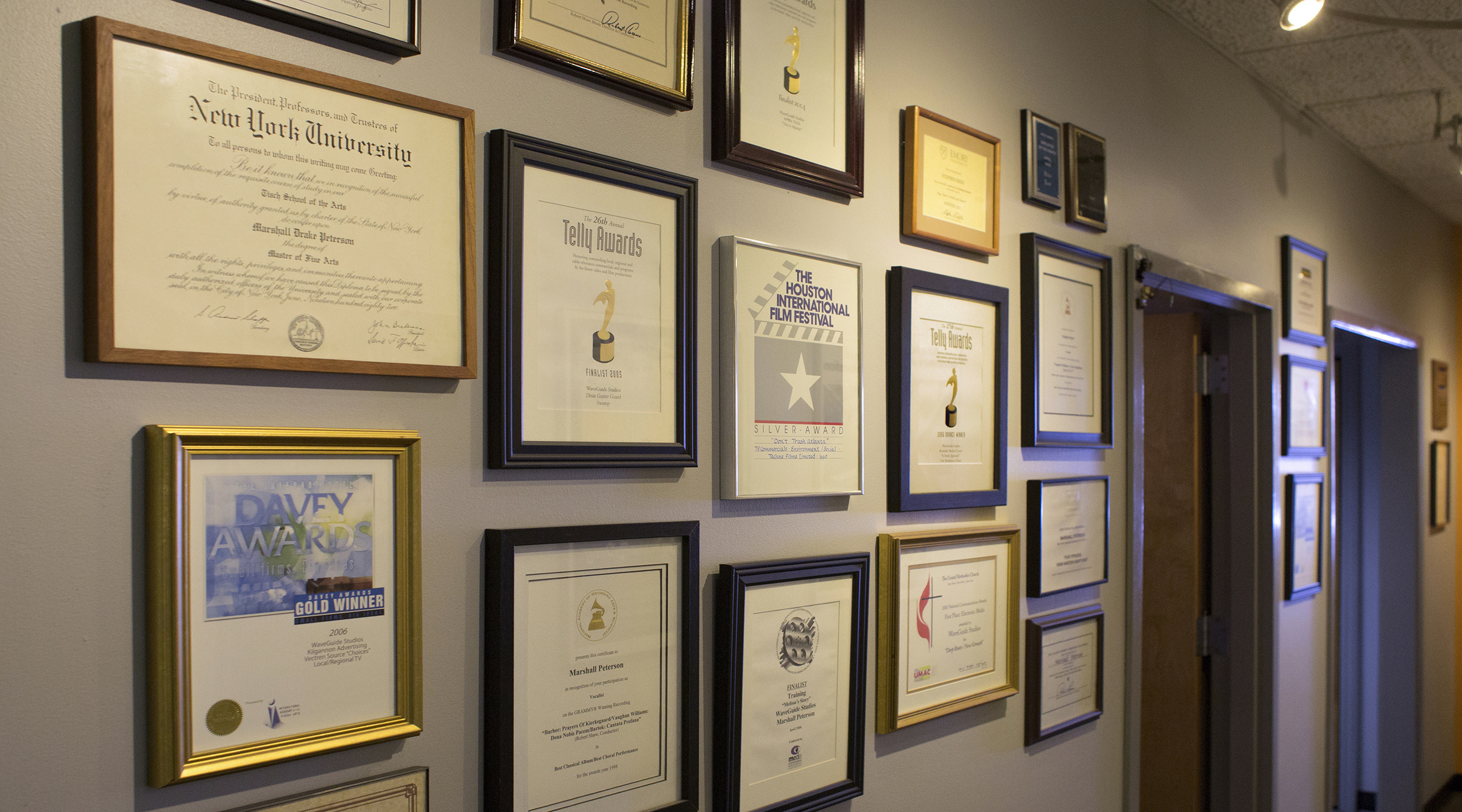 """Our walls are festooned with awards won by WaveGuide Studios and our team, along with some really cool movie posters (check out our first edition """"Barry Lyndon"""", for instance). There's a wide range of awards – some of Steve's Grammys from his years with the ASOC, and also his """"Employee of the Month"""" at Wolf Camera back in the '80s. You get ten points if you find Marshall's Valedictorian trophy from Columbine High School."""