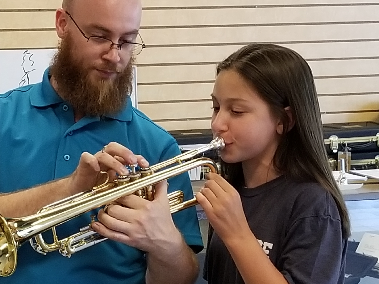 photo of student mouthpiece testing the trumpet