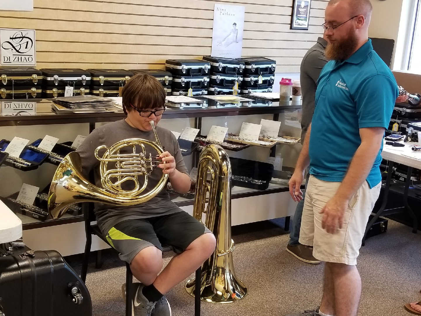 photo of student mouthpiece testing the french horn