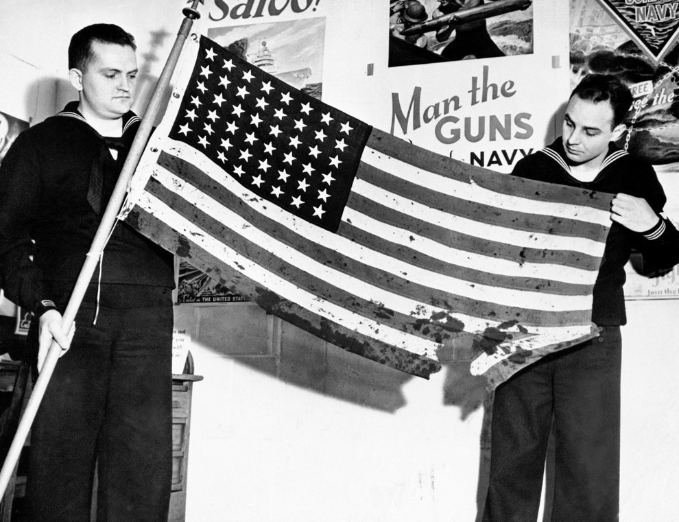 This oil stained, battle torn American flag was flying proudly from a ship in Pearl Harbor when the Japanese struck..jpg